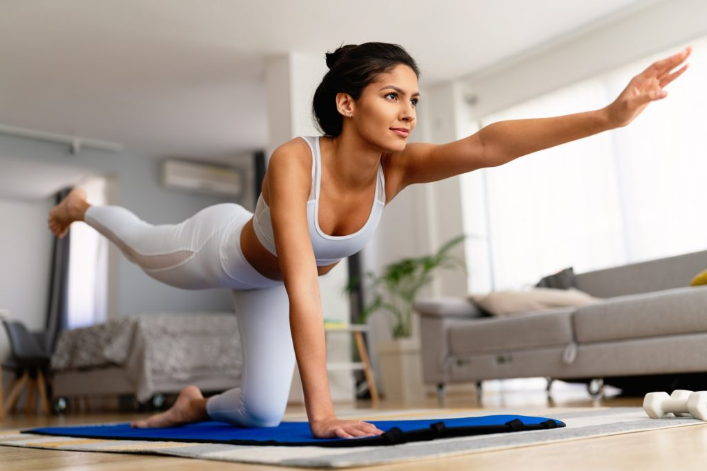 fit-sport-woman-exercising-and-training-at-home