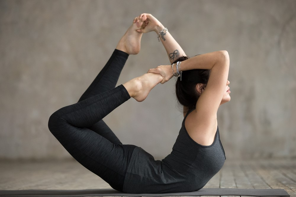 young-woman-bow-exercise1